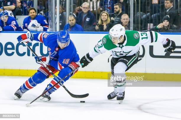 New York Rangers Center JT Miller skates with puck as Dallas Stars Left Wing Mattias Janmark defends during the Dallas Stars and New York Rangers NHL...
