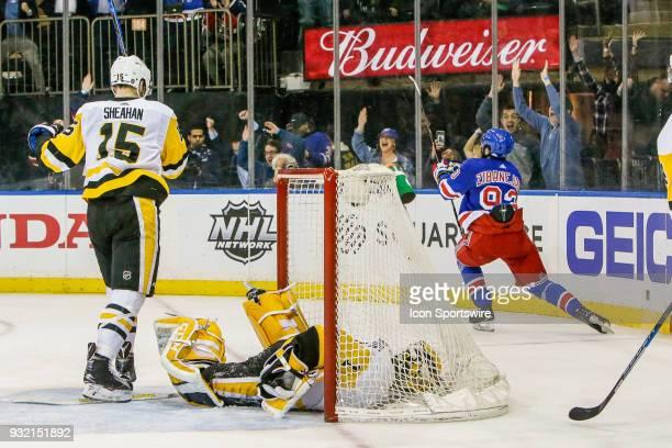 New York Rangers center Mika Zibanejad celebrates winning goal as Pittsburgh Penguins goaltender Casey DeSmith and Pittsburgh Penguins center Riley...