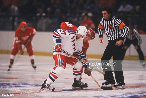 New York Rangers' center Mike Rogers wins a faceoff against the Detroit Red Wings during a game at Madison Square Garden circa 1982 in New York New...