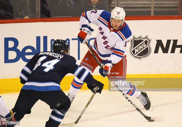 New York Rangers Center Peter Holland makes a centering pass during a NHL game between the Winnipeg Jets and New York Rangers on February 11 2018 at...