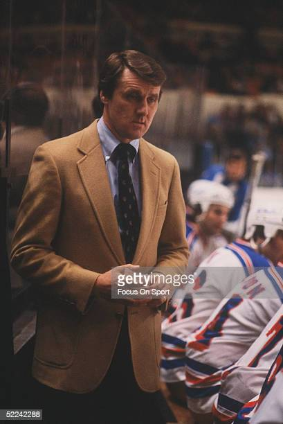 New York Rangers' coach Herb Brooks watches the action from the player's box during a game at Madison Square Garden circa 1982 in New York New York