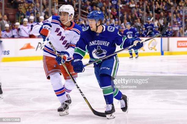 New York Rangers Defenceman John Gilmour defends against Vancouver Canucks left wing Brendan Leipsic during their NHL game at Rogers Arena on...
