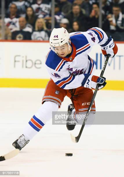 New York Rangers Defenceman Neal Pionk skates with the puck during a NHL game between the Winnipeg Jets and New York Rangers on February 11 2018 at...