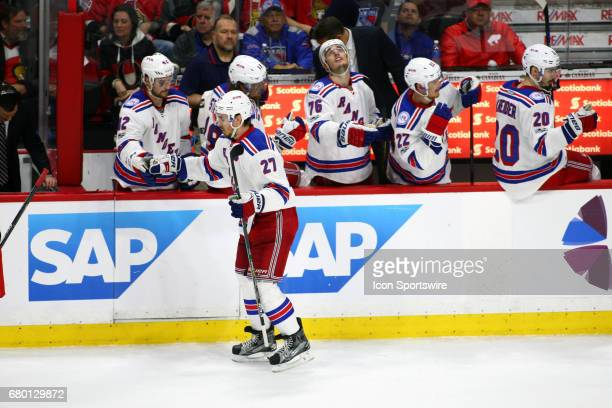 New York Rangers Defenceman Ryan McDonagh taps gloves with New York Rangers Defenceman Brendan Smith after scoring during the second period of Game 5...