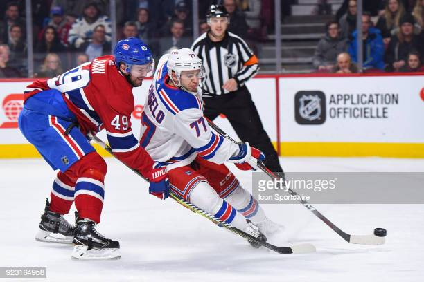 New York Rangers Defenceman Tony DeAngelo gains control of the puck before Montreal Canadiens Winger Logan Shaw during the New York Rangers versus...