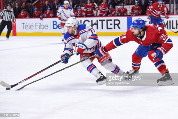 New York Rangers Defenceman Tony DeAngelo gains control of the puck over Montreal Canadiens Center Phillip Danault during the New York Rangers versus...