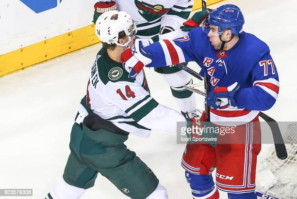 New York Rangers Defenceman Tony DeAngelo lands a punch to the jaw of Minnesota Wild Center Joel Eriksson Ek during the National Hockey League game...