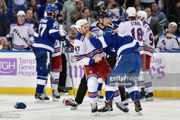 New York Rangers defender Steven Kampfer fights Tampa Bay Lightning right wing JT Brown during an NHL game between the New York Rangers and the Tampa...