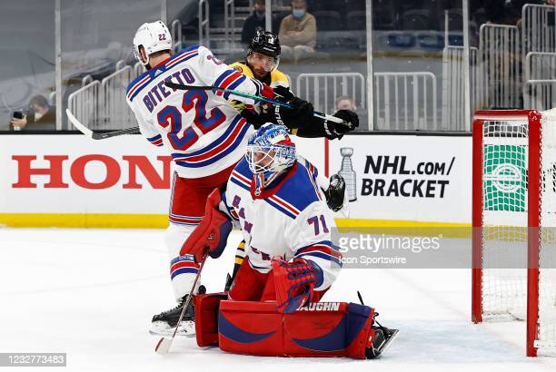 New York Rangers defenseman Anthony Bitetto keeps Boston Bruins center Craig Smith from New York Rangers goalie Keith Kinkaid during a game between...