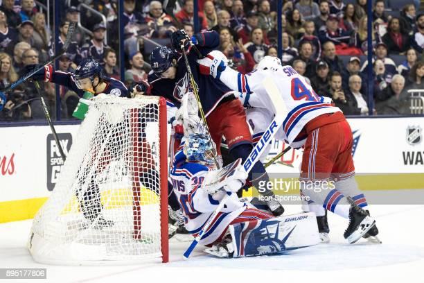 New York Rangers defenseman Brendan Smith pushes Columbus Blue Jackets right wing Josh Anderson into New York Rangers goalie Henrik Lundqvist as he...
