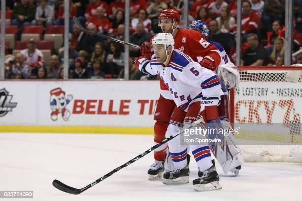 New York Rangers defenseman Dan Girardi gets position in front of the goal against Detroit Red Wings forward Thomas Vanek of Austria during a regular...