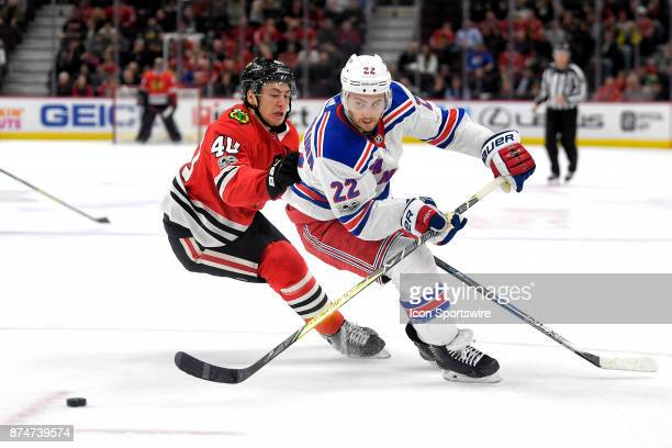 New York Rangers defenseman Kevin Shattenkirk battles with Chicago Blackhawks right wing John Hayden in the third period during a game between the...