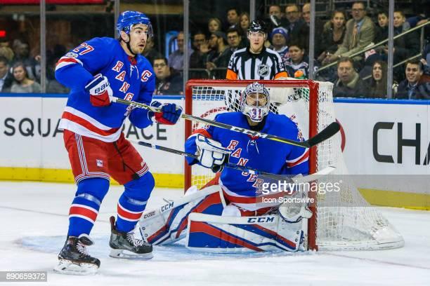 New York Rangers Defenseman Ryan McDonagh and New York Rangers Goalie Ondrej Pavelec track flying puck during the Dallas Stars and New York Rangers...