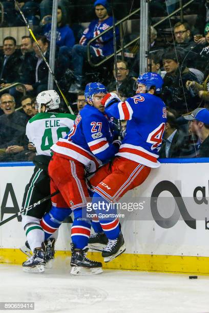 New York Rangers Defenseman Ryan McDonagh and New York Rangers Defenseman Brendan Smith collide near Dallas Stars Left Wing Remi Elie during the...
