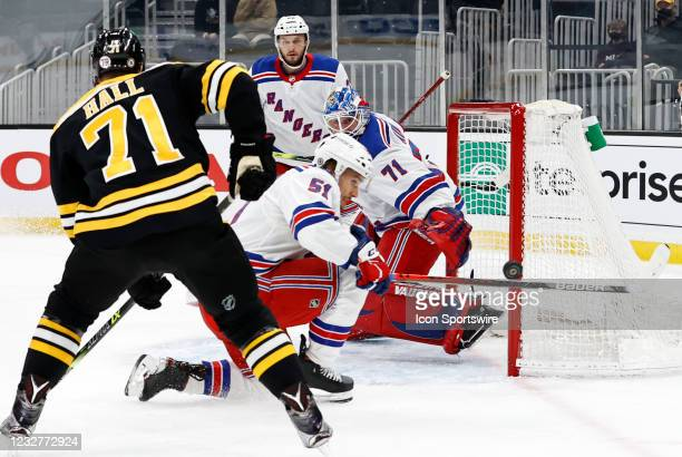 New York Rangers defenseman Tarmo Reunanen blocks a shot during a game between the Boston Bruins and the New York Rangers on May 8 at TD Garden in...
