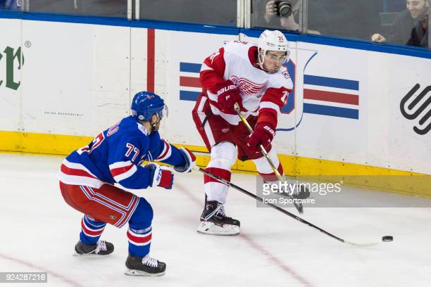 New York Rangers Defenseman Tony DeAngelo deflects a centering pass from Detroit Red Wings Center Dylan Larkin during the second period of a regular...