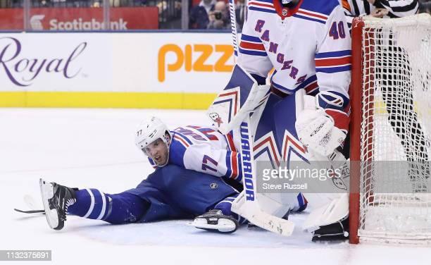TORONTO ON MARCH 23 New York Rangers defenseman Tony DeAngelo lays on top of Toronto Maple Leafs center John Tavares as the Toronto Maple Leafs lose...