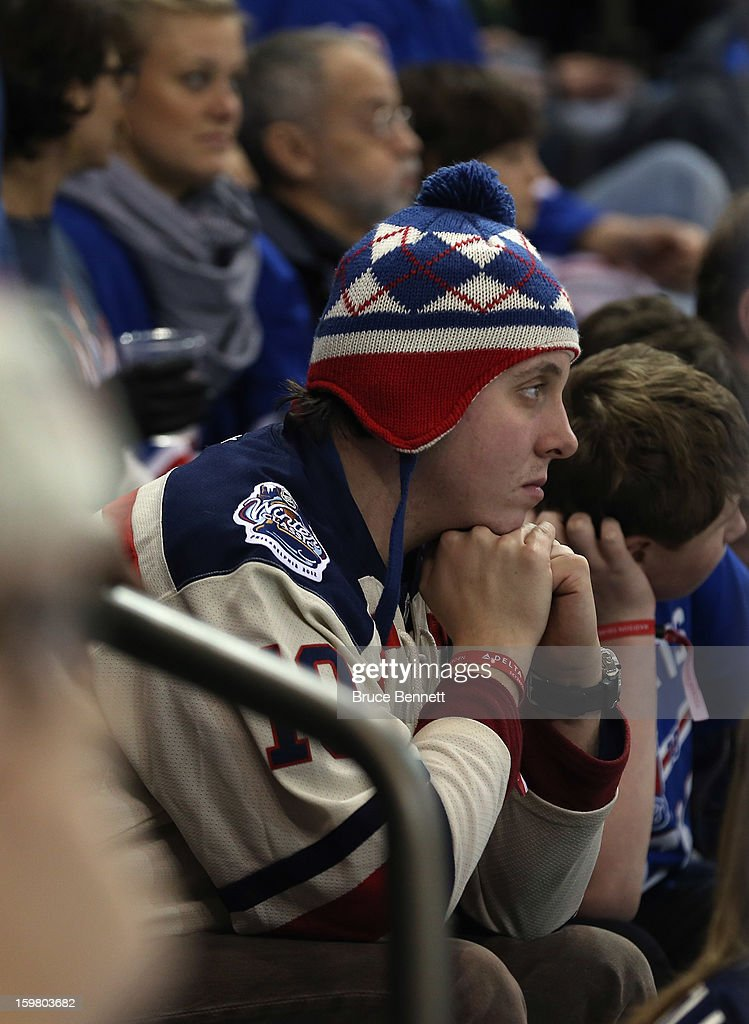 A New York Rangers fan looks dejected late in the third period during a 6-3 loss to the Pittsburgh Penguins at Madison Square Garden on January 20, 2013 in New York City.