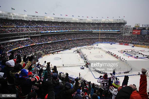 New York Rangers fans celebrate a goal for their team during the New York Rangers Vs New Jersey Devils NHL regular season game held outdoors at...