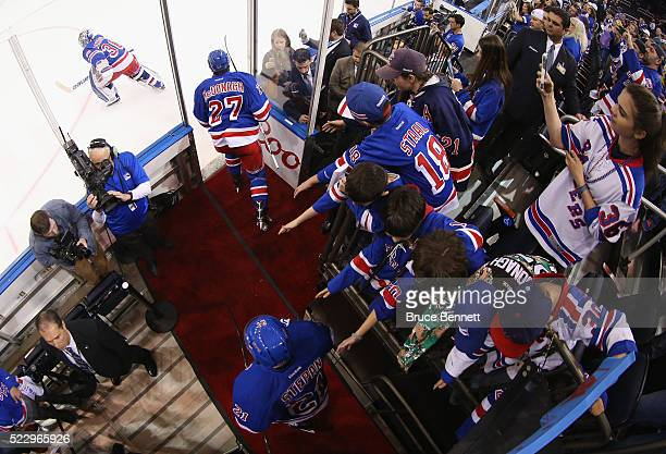 New York Rangers fans watch the players take warmups prior to the game against the Pittsburgh Penguins in Game Four of the Eastern Conference First...