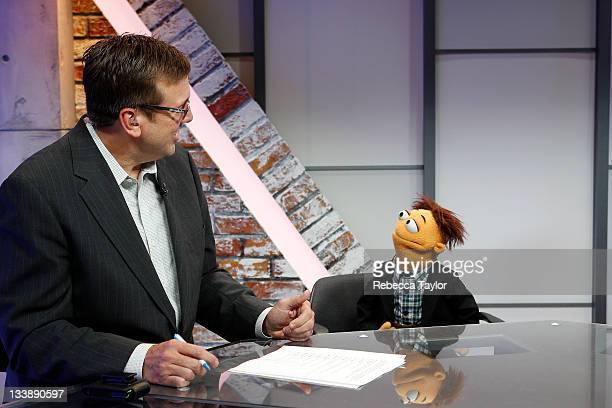 New York Rangers forward Brian Boyle actor Jason Segel and his THE MUPPETS movie costar Walter on the set of Cisco NHL Live at the NHL Powered by...