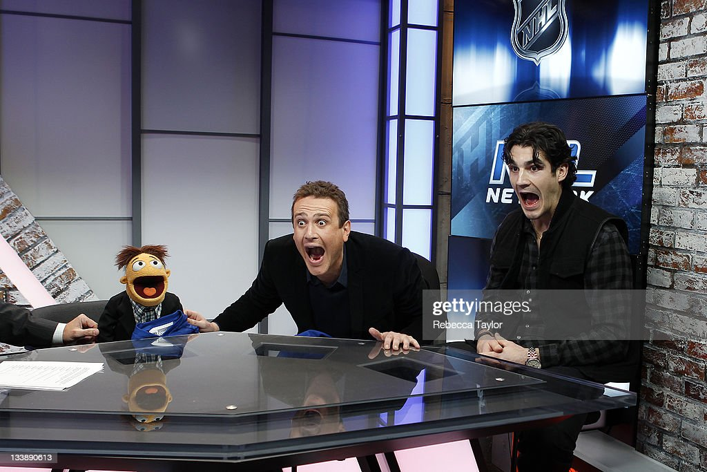 New York Rangers forward Brian Boyle, actor Jason Segel and his THE MUPPETS movie co-star, Walter, making 'the Muppet face' on the set of Cisco NHL Live! at the NHL Powered by Reebok store on November 21, 2011 in New York City.