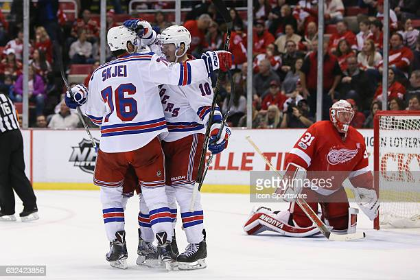 New York Rangers forward JT Miller of Norway receives congratulations from New York Rangers forward Mats Zuccarello of Norway and New York Rangers...