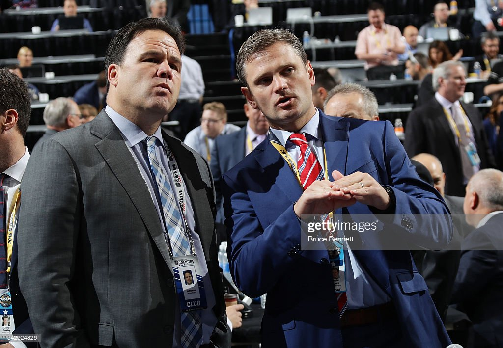 New York Rangers General Manager Jeff Gorton and New York Rangers Director, European Scouting Nickolai Bobrov looks on during the 2016 NHL Draft on June 25, 2016 in Buffalo, New York.