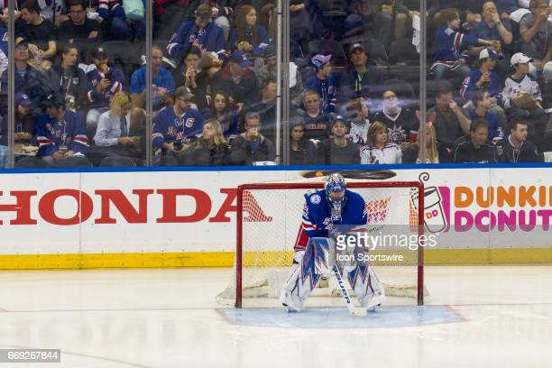 New York Rangers goalie Henrik Lundqvist gets ready to start the second period of game 3 of the first round of the 2017 Stanley Cup Playoffs between...