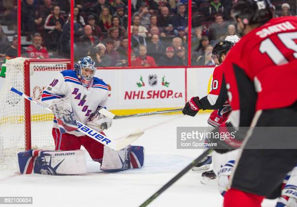 New York Rangers Goalie Henrik Lundqvist makes a body save against Ottawa Senators Left Wing Zack Smith during the first period of the NHL game...