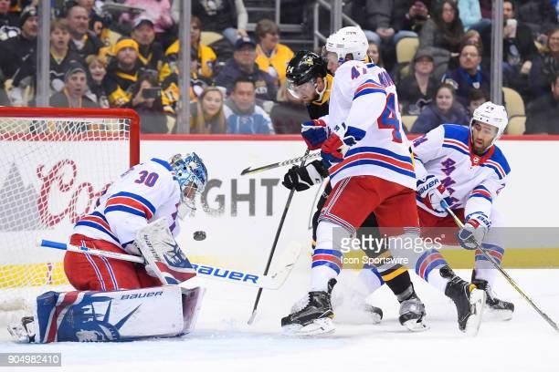 New York Rangers Goalie Henrik Lundqvist makes a seven Pittsburgh Penguins Left Wing Tom Kuhnhackl in front as /New York Rangers Defenseman Steven...