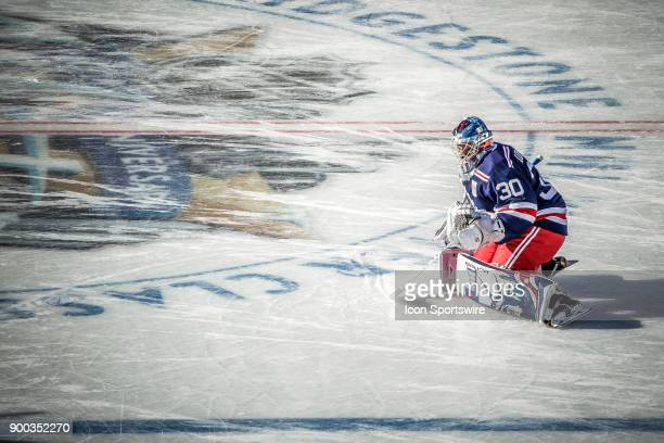 New York Rangers Goalie Henrik Lundqvist performs pregame drill near center ice prior to the New York Rangers and Buffalo Sabres Winter Classic NHL...