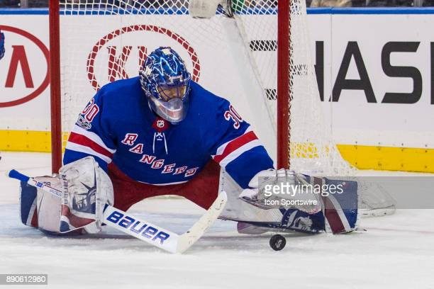 New York Rangers Goalie Henrik Lundqvist reaches out to cover up the puck during the second period of a regular season NHL game between the Carolina...