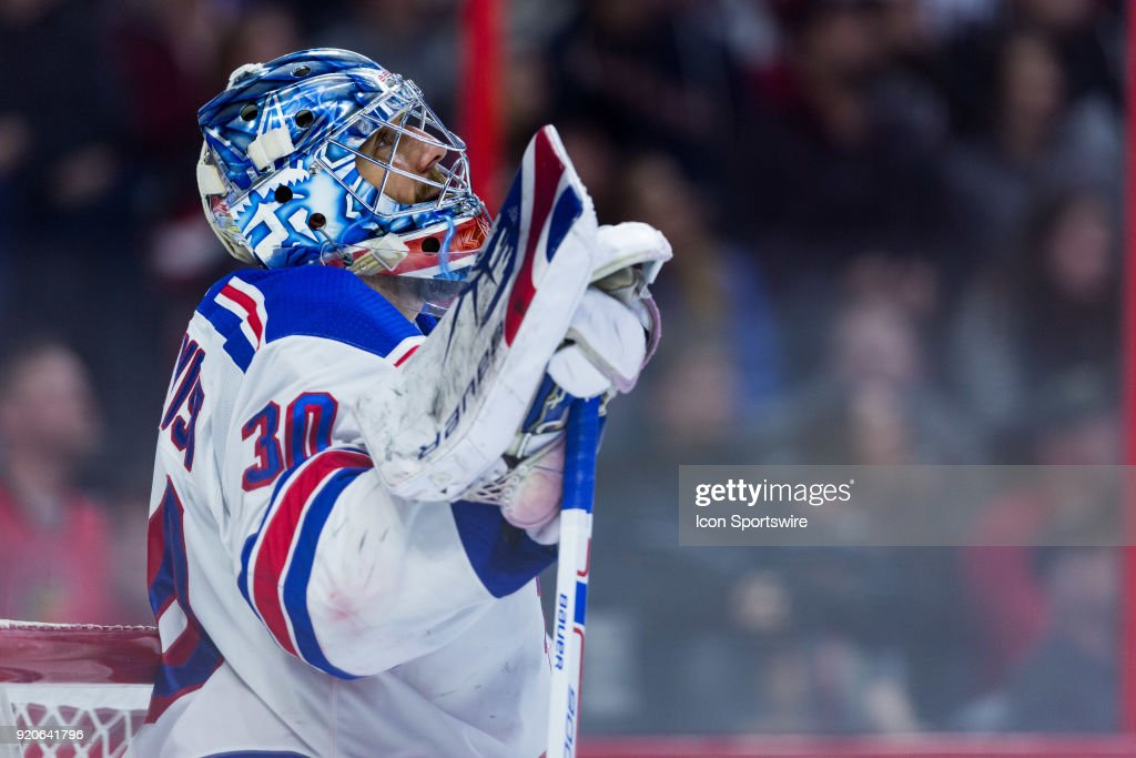 New York Rangers Goalie Henrik Lundqvist (30) rests on his stick while watching the replay as a goal is under review during third period National Hockey League action between the New York Rangers and Ottawa Senators on February 17, 2018, at Canadian Tire Centre in Ottawa, ON, Canada.