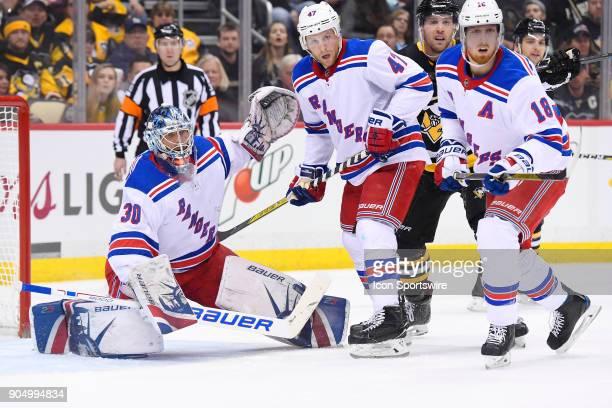 New York Rangers Goalie Henrik Lundqvist tends net as New York Rangers Defenseman Steven Kampfer and New York Rangers Defenseman Marc Staal defend...