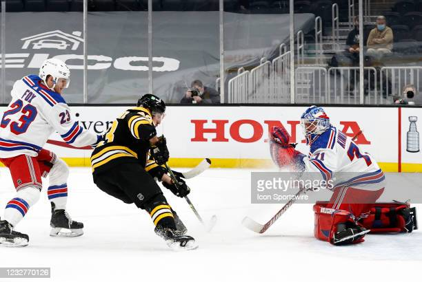 New York Rangers goalie Keith Kinkaid makes a glove save with Boston Bruins left wing Brad Marchand bearing down on the crease during a game between...