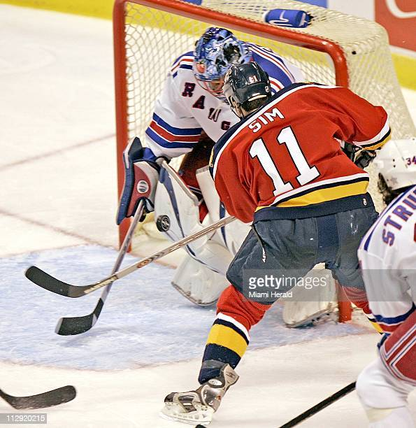 New York Rangers' goalie Kevin Weekes stops a shot from Florida Panthers' Jon Sim in the second period during the Panthers 32 win over the Rangers at...