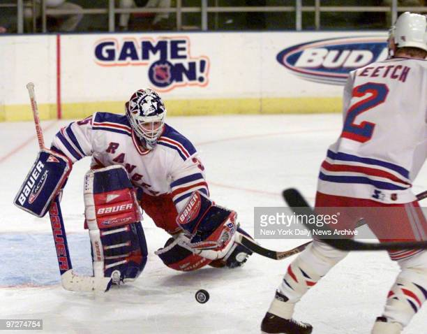 New York Rangers goalie Mike Richter makes a save in game against the Florida Panthers at Madison Square Garden.,
