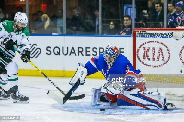 New York Rangers Goalie Ondrej Pavelec prepares to make save on shot by Dallas Stars Right Wing Alexander Radulov during the Dallas Stars and New...