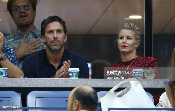 New York Rangers goaltender Henrik Lundqvist of Sweden and his wife Therese Andersson attend the men's semifinals on day 12 of the 2018 tennis US...