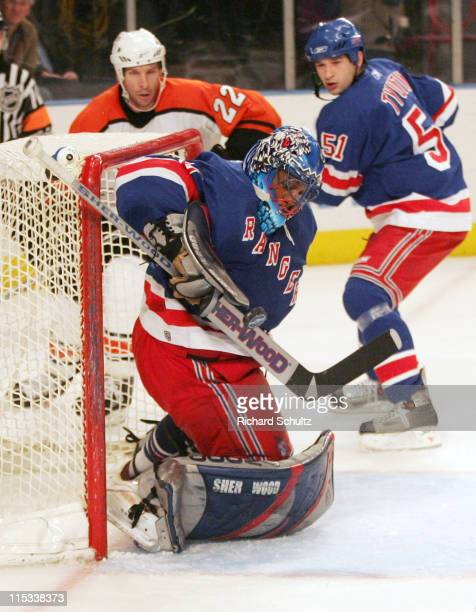New York Rangers' goaltender Kevin Weekes makes a stick save against the Philadelphia Flyers during the first period at Madison Square Garden in New...