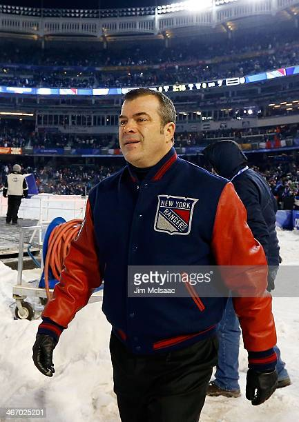 New York Rangers head coach Alain Vigneault looks on during the game against the New York Islanders during the 2014 Coors Light NHL Stadium Series at...