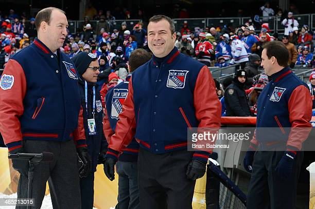 New York Rangers head coach Alain Vigneault looks on prior to the 2014 Coors Light NHL Stadium Series against the New Jersey Devils at Yankee Stadium...