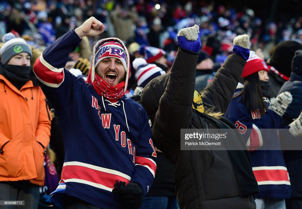 New York Rangers hockey fans cheer on their team as they attend the 2018 Bridgestone NHL Winter Classic between the New York Rangers and the Buffalo Sabres at Citi Field on January 1, 2018 in the Flushing neighborhood of the Queens borough of New York City.