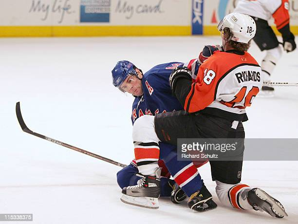 New York Rangers' Jaromir Jagr left gets tangled up with Philadelphia Flyers' Mike Richards during the second period at Madison Square Garden in New...