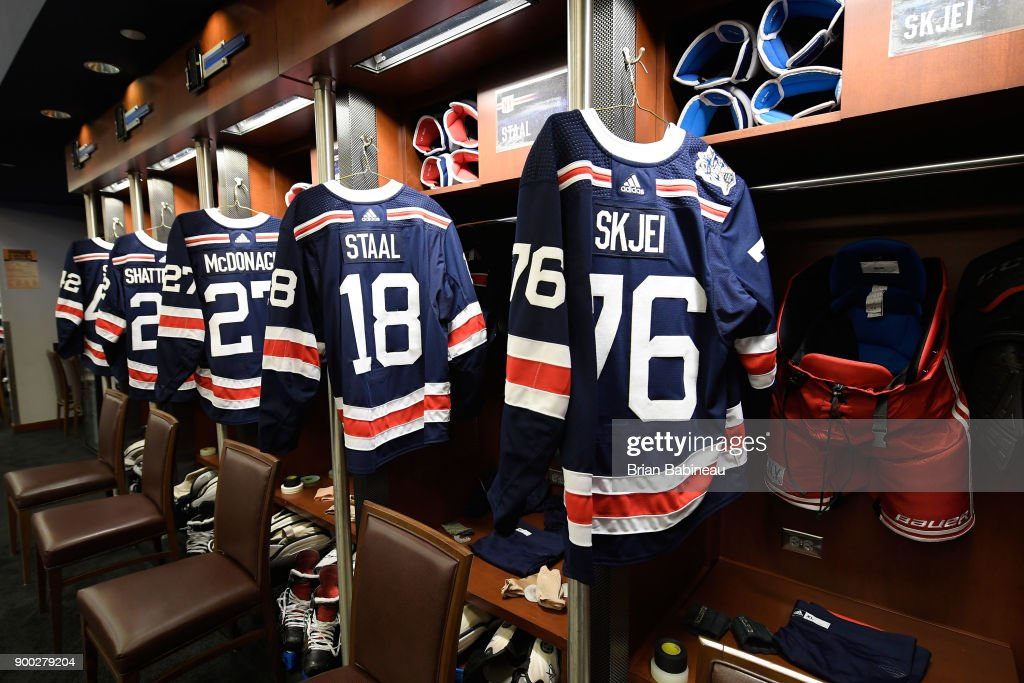 new style a22b6 acaa4 New York Rangers jerseys hang in the locker room prior to ...