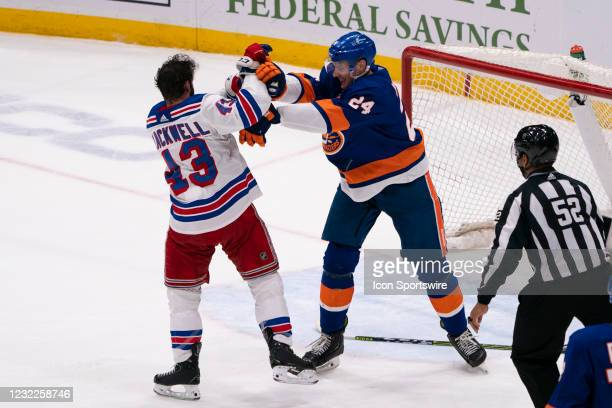 New York Rangers Left Wing Alexis Lafreniere and New York Islanders Defenseman Scott Mayfield fight during the second period of the National Hockey...