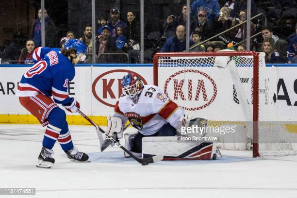New York Rangers Left Wing Artemi Panarin works around Florida Panthers Goalie Samuel Montembeault during an Eastern Conference matchup between the...