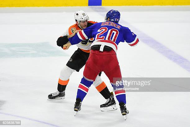 New York Rangers Left Wing Chris Kreider and Philadelphia Flyers Defenceman Brandon Manning fight during a National Hockey League game between the...