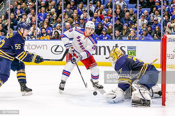 New York Rangers Left Wing Chris Kreider shoots as Buffalo Sabres Goalie Anders Nilsson prepares to make save and Buffalo Sabres Defenseman Rasmus...
